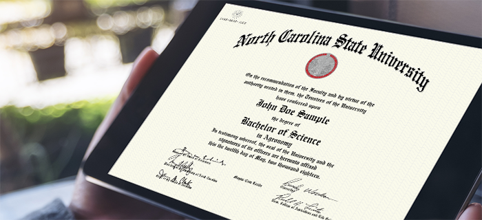 A student holds a tablet that shows his certified electronic diploma from North Carolina State University, also known as his CeDiploma.
